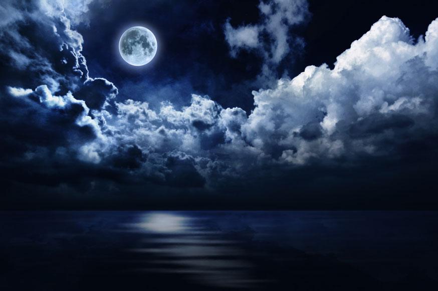 full-moon-in-night-sky-over-water