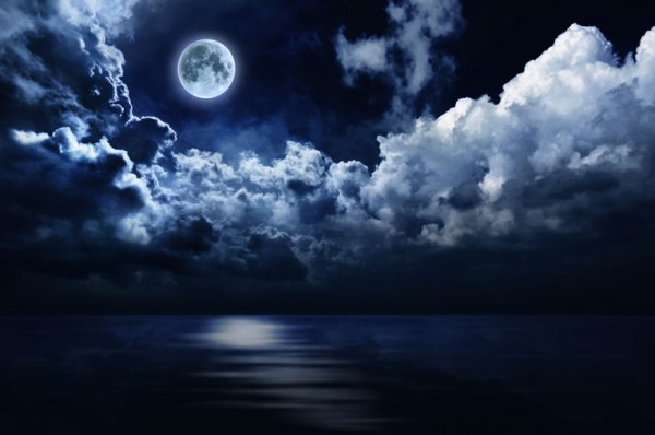 full-moon-in-night-sky-over-water