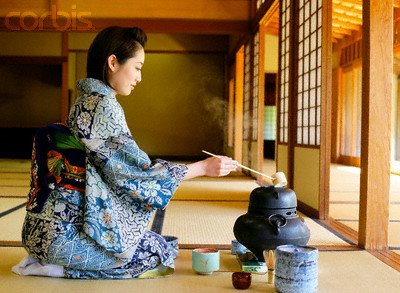 Japanese Woman in a Kimono Making Tea